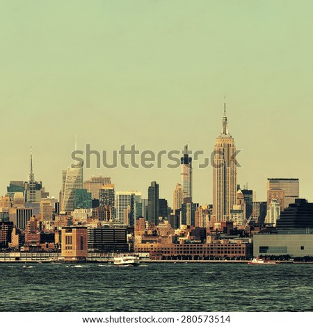 NEW YORK CITY, NY - JUL 11: Empire State Building and skyline on July 11, 2014 in New York City. It is a 102-story landmark and was world's tallest building for more than 40 years. - stock photo