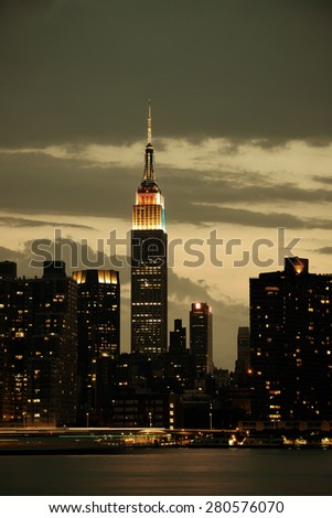NEW YORK CITY, NY - JUL 11: Empire State Building at night on July 11, 2014 in New York City. It is a 102-story landmark and was world's tallest building for more than 40 years. - stock photo