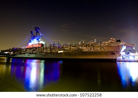 NEW YORK CITY, NY - JULY 9: The USS Intrepid, one of 24 Essex-class aircraft carriers built during World War II for the United States Navy, on July 9, 2011 in Manhattan, New York City. - stock photo