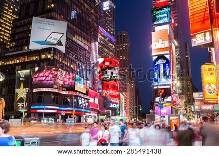 NEW YORK CITY, NY - JUN 24: Times Square and Broadway Theaters at night is one of  the most tourist visited location in New York City on June 24, 2014