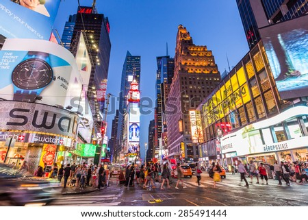 NEW YORK CITY, NY - JUN 24: Times Square and Broadway Theaters at night is one of  the most tourist visited location in New York City on June 24, 2014 - stock photo