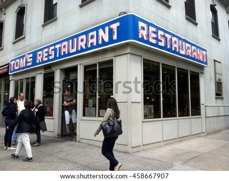 New York City, NY - June 20, 2014: Toms Restaurant location setting of famous TV sitcom Seinfeld on NBC called Monks Coffee Shop in show. Fictional characters meeting place. Tourists visit real eatery