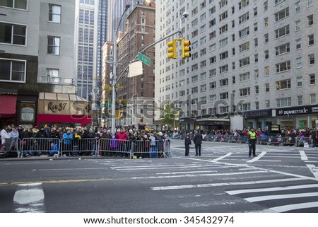 NEW YORK CITY, NY - NOVEMBER 26 - Crowd of people on 6th avenue and 57th Street waiting for the Macy's 89th Annual Thanksgiving day parade to start on November 26, 2015 in New York City, New York. - stock photo