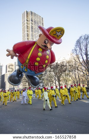 NEW YORK CITY, NY - NOVEMBER 28: Fire Department balloon in the Macy's 87th Annual Thanksgiving Day Parade on November 28, 2013 in New York City, New York.  - stock photo
