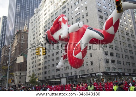 NEW YORK CITY, NY - NOVEMBER 26: Red Power Ranger balloon flown through city street during the 89th Annual Macy's Thanksgiving Day Parade on November 26, 2015 in New York City.  - stock photo