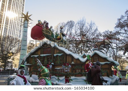 NEW YORK CITY, NY - NOVEMBER 28 : Santa and Mrs. Claus on float going through W 59th ST during the Macy's 87th Annual Thanksgiving Day Parade on November 28, 2013 in New York City, New York.  - stock photo