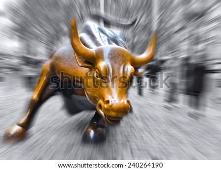 NEW YORK CITY, NY - OCT 11: Charging Bull sculpture on October 11, 2013 in New York City. The sculpture is both a popular tourist destination and a symbol of the New York Stock Exchange. - stock photo
