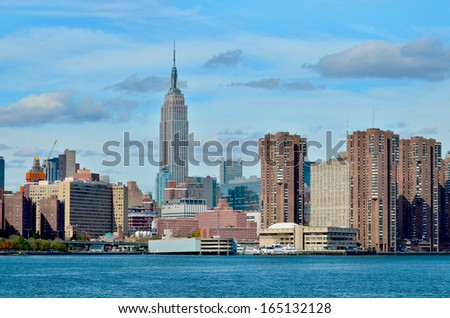 NEW YORK CITY, NY - OCT 29: Midtown and the Empire State Building on Oct. 29, 2013 in New York City. Empire State Building is a 102-story landmark. It was world's tallest building for more than 40 years - stock photo