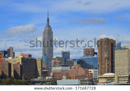 NEW YORK CITY, NY - OCT 29: Midtown and the Empire State Building on oct. 29, 2013 in New York City. Empire State Building is a 102-story landmark was world's tallest building for more than 40 years - stock photo