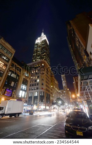 NEW YORK CITY, NY - OCT 29: The Empire State Building at night on Oct. 29, 2013 in New York City. Empire State Building is a 102-story landmark. It was world's tallest building for more than 40 years  - stock photo