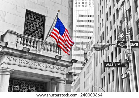 NEW YORK CITY, NY - OCT 11: The side entrance of New York Stock Exchange and a street sign of Wall Street shown on October 11, 2013 in New York City. The Exchange building was built in 1903. - stock photo