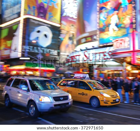 NEW YORK CITY, NY - SEP 5: Times Square with Taxi and Theater on September 5, 2010 in Manhattan, New York City. Times Square is featured with Broadway Theaters and LED signs as a symbol of NYC. - stock photo