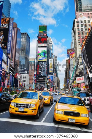 NEW YORK CITY, NY - SEP 5: Times Square with yellow taxi on September 5, 2011 in Manhattan, New York City. Times Square is featured with Broadway Theaters and LED signs as a symbol of New York City.  - stock photo