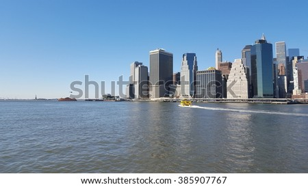 New York City, NY, USA - February 18, 2016: View on Manhattan from Brooklyn Bridge Park in New York City. Mobile photo.