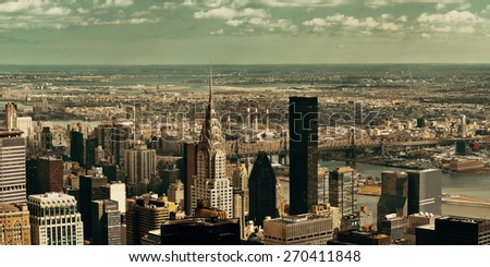 NEW YORK CITY, NY, USA - JUL 12: Chrysler Building and skyline on July 12, 2014 in Manhattan, New York City. It was designed by William Van Alena as Art Deco architecture and the famous landmark. - stock photo