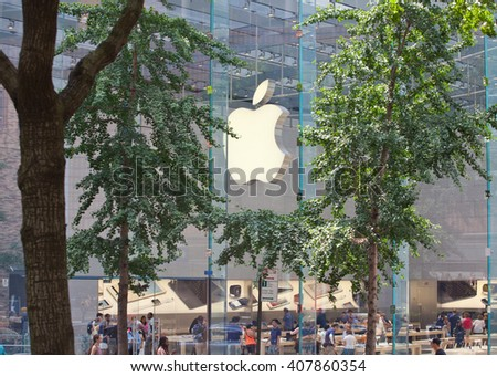 New York City, NY, USA - July 07, 2015: The Apple store located at the corner of Broadway and 67th street in Manhattan, particular views through the trees. - stock photo