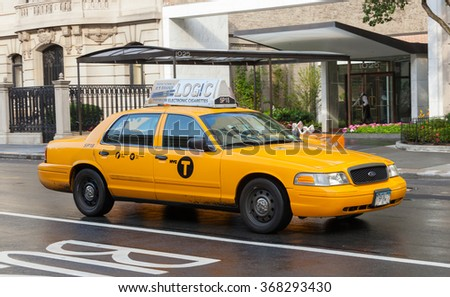 NEW YORK CITY, NY, USA - JULY 07, 2015: Yellow cabs in Manhattan in a rainy day. The taxicabs of New York City are widely recognized icons of the city.