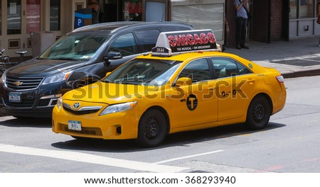 NEW YORK CITY, NY, USA - JULY 07, 2015: Yellow cabs in Manhattan, NYC. The taxicabs of New York City are widely recognized icons of the city. - stock photo