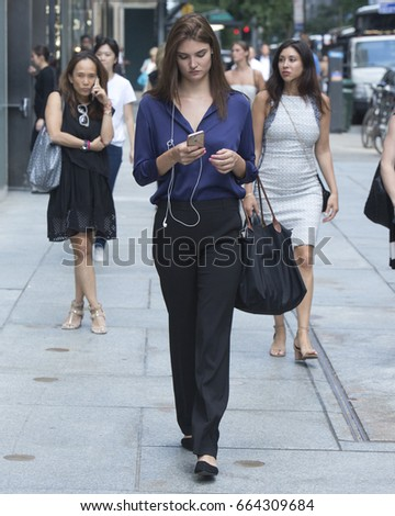 New York City, NY, USA - June 20, 2017: A woman walks in midtown New York City.