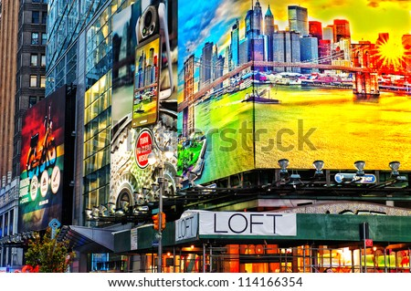 NEW YORK CITY, NY, USA-MAY 5: Illuminated facades by night on May 5, 2011 at Times Square in NYC. Times Square is a symbol of New York City and the United States. - stock photo