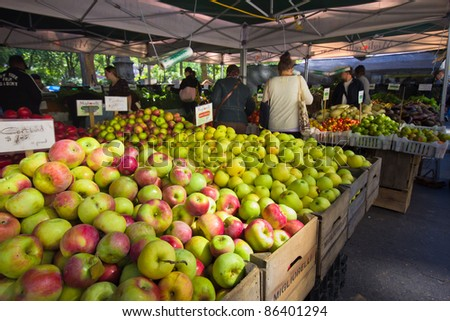 NEW YORK CITY - OCT. 7:  Apples and other produce are for sale at Union Square Greenmarket in New York City on Oct. 7, 2011.  This world famous farmers' market began in 1976 and has grown to 140 farmers during peak season. - stock photo