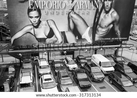 NEW YORK CITY- OCT 2, 2009: Billboard featuring Victoria and David Beckham in an ad for Emporio Armani underwear. Located in the city's trendy Meatpacking District. Black and white image. - stock photo