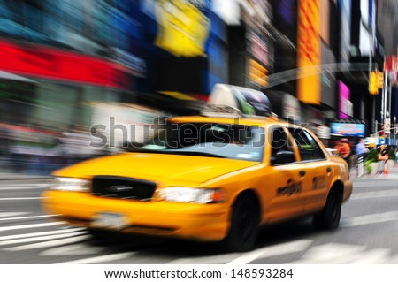 NEW YORK CITY - OCT 15: New York yellow cab in Time Square on October 15, 2010.It's one of the world's busiest pedestrian intersections and a major center of the world's entertainment industry. - stock photo