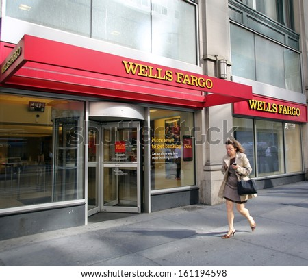 NEW YORK CITY - OCT 24 2013:  Pedestrians walk past a branch office of Wells Fargo & Company bank in Manhattan on Sunday, October 20, 2013.  - stock photo