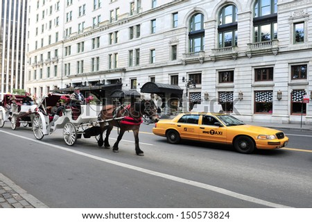 NEW YORK CITY - OCT 12:People enjoy Horse and Carriage rides in Manhattan on Oct 12 2009. Horse Drawn Carriages are a popular way to experience the beauty of New York City.