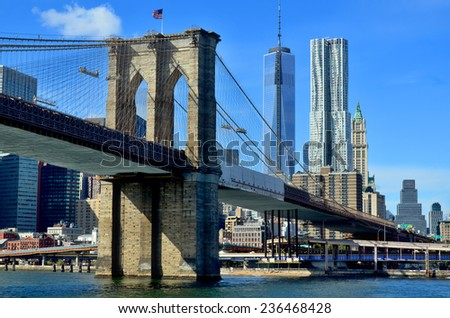 NEW YORK CITY OCT 27:The Financial District penthouses of New York by Frank Gehry, One World Trade Center or Freedom Tower and Brooklyn Bridge on Oct 27, 2013 in New York - stock photo