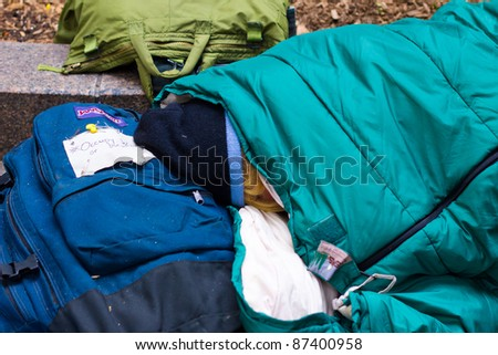 NEW YORK CITY - OCT. 21:  Unidentified protester sleeps in sleeping bag at Occupy Wall Street demonstration in NYC's Zuccotti Park on Oct 21, 2011.  The protest began on Sept 17. - stock photo