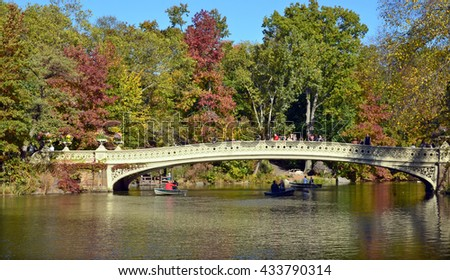 NEW YORK CITY - OCT 27: 2013:  View of the Bow Bridge at Central Park in New York City.  The first cast-iron bridge in the Park (second oldest in America), the bridge was built between 1859 and 1862. - stock photo