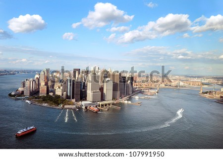 NEW YORK CITY - OCTOBER 13: Aerial view of  Manhattan Island New York City on October 13, 2009.Manhattan is the most densely populated and the oldest of the five boroughs of New York City. - stock photo