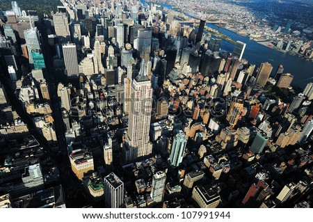 NEW YORK CITY - OCTOBER 13: An aerial view of the Empire State Building on October 13, 2009 in New York.The building is a 102-story landmark and American cultural icon in New York City. - stock photo