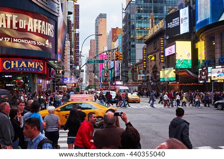 NEW YORK CITY - OCTOBER 18, 2014: corner of W 42nd Street and 7th Avenue in the entertainment area with movie theatres and bilboards - stock photo