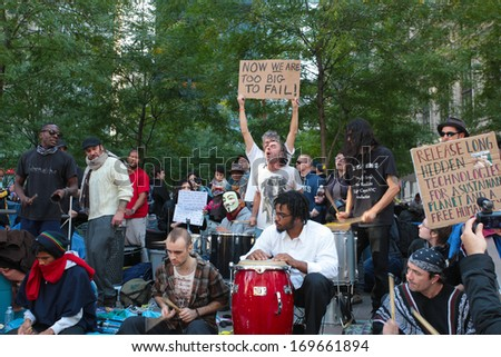 NEW YORK CITY - OCTOBER 11 2011: Drum circle performs as Occupy Wall Street activists camped at Zuccotti Park from September 17 2011 to November 14 2011 when evicted by the NYPD - stock photo