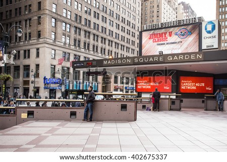 NEW YORK CITY - OCTOBER 25, 2013: Exterior view of Madison Square Garden in midtown Manhattan with people visible.