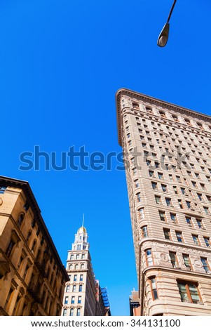 NEW YORK CITY - OCTOBER 10, 2015: Flatiron Building in Manhattan. Its a teel framed historical skyscraper, designated as NYC landmark and National Historic Landmark and registered in Historic Places