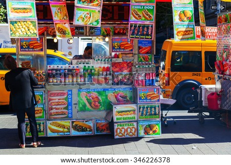 NEW YORK CITY - OCTOBER 07, 2015: food stand in Manhattan with Halal food and unidentified people. Halal food carts with gyros, chicken, rice and other food are spreaded over Manhattan.