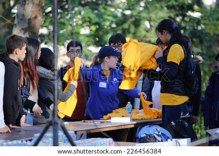NEW YORK CITY - OCTOBER 26 2014: Free To Breathe, an organization dedicated to raising funds for lung cancer research & treatment, held its first ever 5K run/walk in Cadman Plaza, Brooklyn - stock photo