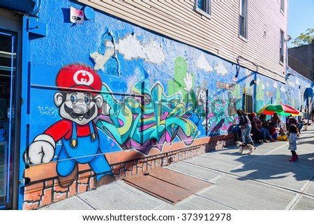 NEW YORK CITY - OCTOBER 11, 2015: graffiti of Super Mario in Hunts Point, Bronx, with unidentified people. Super Mario is the most popular video game character of the world renown Nintendo company - stock photo