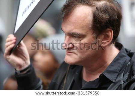 NEW YORK CITY - OCTOBER 24 2015: More than one thousand activists marched on behalf of the families of victims of alleged police brutality in #RiseUpOctober. Filmmaker Quentin Tarantino - stock photo