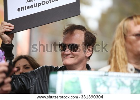 NEW YORK CITY - OCTOBER 24 2015: More than one thousand activists marched on behalf of the families of victims of alleged police brutality in RiseUpOctober. Filmmaker Quentin Tarantino on stage - stock photo