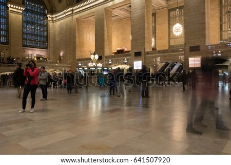 New York City - 1 October 2016: Motion blur of commuters hurrying through the Main Concourse of Grand Central Terminal in Manhattan in the early evening. People walking through the Main Concourse.