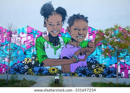 NEW YORK CITY - OCTOBER 10, 2015: mural art in Bushwick, Brooklyn. Bushwick is one of NYCs major street art hubs, with an outdoor art gallery known as the Bushwick Collective - stock photo
