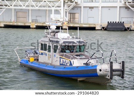NEW YORK CITY - OCTOBER 30: NYPD Police boat leaving pier for patrol sevice in NYC on October 30, 2014.The Police Department (NYPD), established in 1845,is the largest municipal police force in the US - stock photo