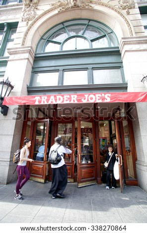 NEW YORK CITY - OCTOBER 22, 2015: Pedestrians walk past a Trader Joes's supermarket. Trader Joe's is an American privately held chain of specialty grocery stores - stock photo