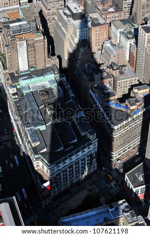 NEW YORK CITY - OCTOBER 12: The shadow of the Empire State building shading over Manhattan on October 12 2009. The building is a 102-story landmark and American cultural icon in NYC.