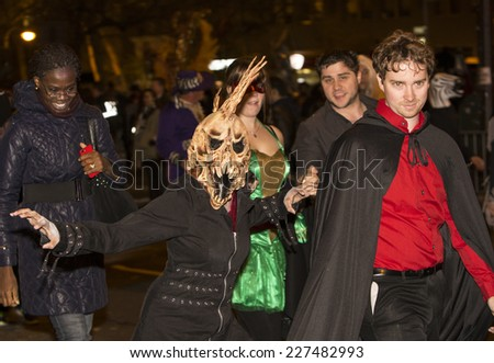 NEW YORK CITY - OCTOBER 31 2014: the 41st annual West Village Halloween parade filled Sixth Avenue with vividly costumed participants while thousands more watched from the sidelines