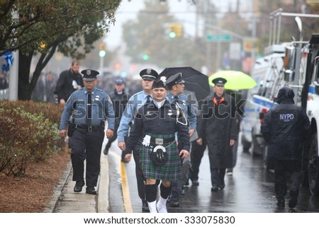 NEW YORK CITY - OCTOBER 28 2015: Thousands of police officers joined slain NYPD officer Randolph Holder's family & elected officials for funeral services at Greater Allen AME